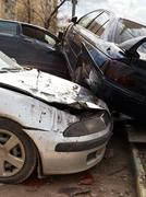 Three broken cars during road accident Stock Photos