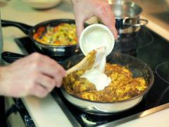 Man adding sour cream to cooked meal NTSC Stock Footage