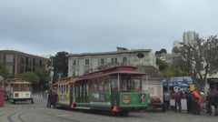 San Francisco cable car wait line people tourist boarding station cloudy day USA Stock Footage