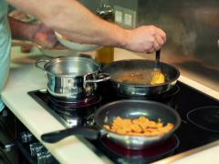 Man cooking in the kitchen NTSC Stock Footage