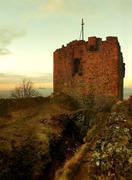 The stony ruin of medieval stronghold on the peak of rocky hill Stock Photos