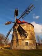 Renewal wind mill house into summer house. New red roof, repaired wind blades. - stock photo