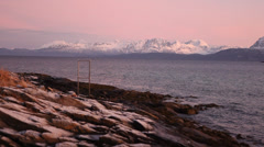Norther Norway magical light on white mountains and blue sea Stock Footage