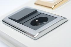 Black socket and light switch combination Stock Photos