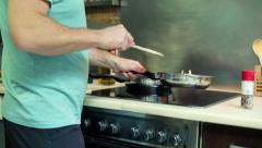 Man mixing vegetables on frying pan HD Stock Footage