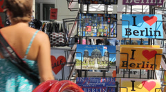 """""""I love Berlin"""" tourist post cards in a souvenir shop in Mitte Stock Footage"""