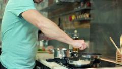 $Man squeezing lemon on vegetables, pan in the kitchen HD Stock Footage