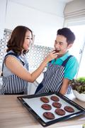 Couples in domestic kitchen with breakfast - stock photo