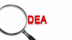 "Magnifier enlarges the word ""idea"" Stock Footage"