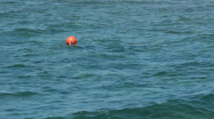 5567 Sea surface, calm blue waves with a red buoy Stock Footage
