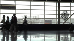 Slow motion silhouette crowd waking in airport Stock Footage
