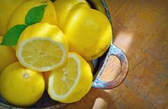 Fresh lemons on a wood table Stock Photos