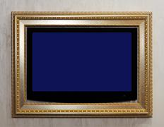 lcd tv in retro style golden frame - stock photo