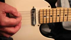 Close up of strumming guitar - using slider Stock Footage