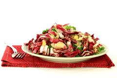 gourmet salad from radicchio, endive and seasonings - stock photo