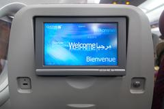 Economy class seat with entertainment system onboard. Stock Photos