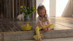 Girl in the company of ducklings and rabbit turd scour Stock Footage