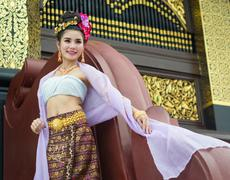 Thai woman in traditional costume of thailand Stock Photos