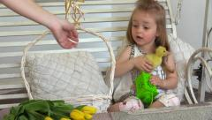 Girl disagree and make its own way - put duckling back to basket Stock Footage