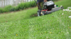 Slider and zoom on mowing side of hill Stock Footage