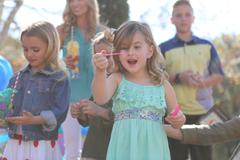children enjoying a fashionable outdoor birthday party - stock photo