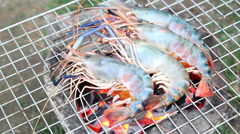 Delicious shrimps on grill cooking Stock Footage