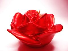 Red rose scented aroma candle Stock Photos
