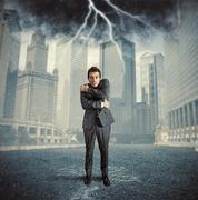 failure concept - man in a storm - stock illustration