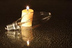 candle and bulb - stock photo