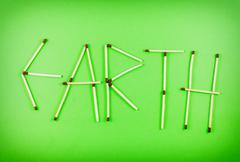 Word earth made of matchsticks Stock Photos