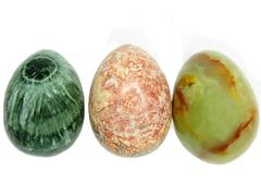 semiprecious mineral clinpchlore jasper and onyx eggs - stock photo