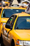 Yellow cab speeds through times square in new york, ny, usa. Stock Photos