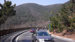 Motorcycle riders on mountain road Stock Footage
