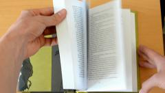 Browsing in a book Stock Footage