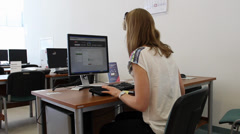 Female student at the computer in the university library. Stock Footage