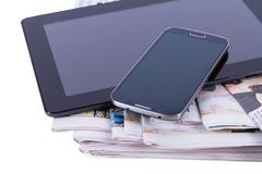 Stock Photo of newspapers, tablet and mobile phone