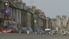Flers in Normandy, car passes row of houses Stock Footage