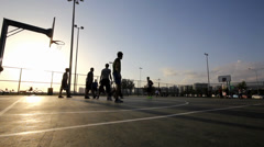 Playing Basketball ,In The Sunset,Behind The Wire Mash - stock footage