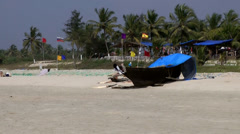 India Goa District Utorda beach 036 boat with an open cover on white sand beach Stock Footage