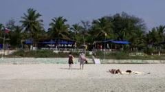 India Goa District Utorda beach 032 people are leaving the white beach - stock footage