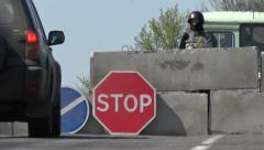 Military roadblock on the highway in Eastern Ukraine. - stock footage