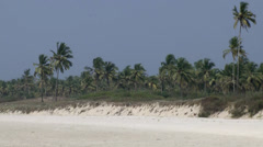 India Goa District Utorda beach 034 white sand beach with green area behind it - stock footage
