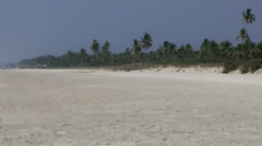 India Goa District Utorda beach 033 very wide deserted beach and green border - stock footage