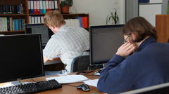 Students at the computer in the university library Stock Footage