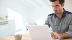 man working from home with laptop - stock footage