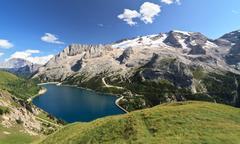 dolomiti - fedaia lake and marmolada mount - stock photo
