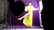 Fashion female model making funny pose during photo shoot Stock Footage