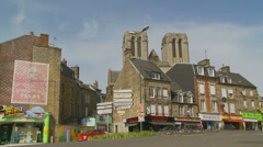 Traffic through Flers in Normandy Stock Footage