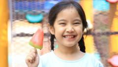 Little Asian girls enjoy eating icecream Stock Footage