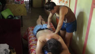 Stock Video Footage of woman massages back of client